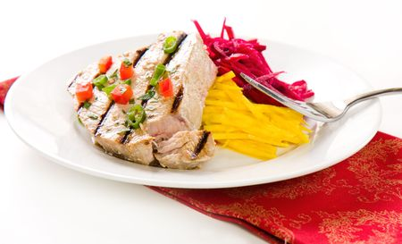 Jalapeno marinated grilled tuna steak with beet and jicama slaw Stock Photo - 5530489