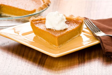 Sweet Potato Pie with a dollop of freshly whipped cream Stock Photo - 5530503