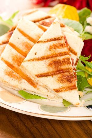 Chicken, bacon, pepper, pear and gouda panini with salad Stock Photo - 5576147