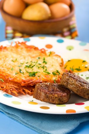 hash: Tasty patty sausage  with egg and crispy hash browns