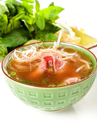 Vietnamese Style pho accompanied by Herbs