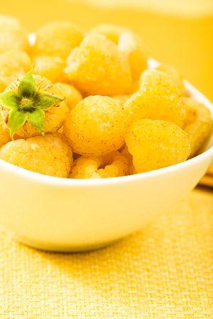 Golden yellow raspberries in yellow setting
