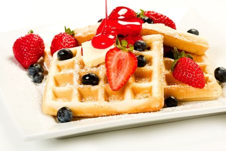 Waffles with fruit and red strawberry syrup Stock Photo