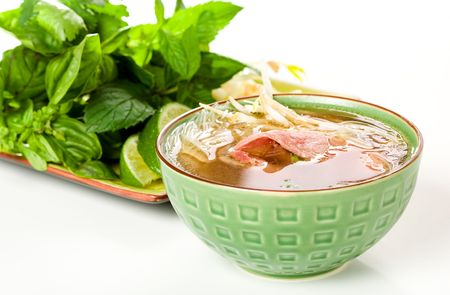 Vietnamese Style pho accompanied by Herbs photo