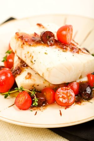Baked cod with tomato and olive salad