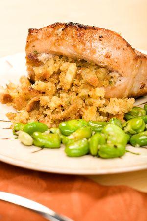 Stuffed pork chop served with fava beans
