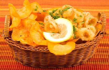 Fried calamari rings with freshly cooked sweet potato chips