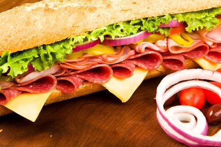 hoagie: Footlong Salami, Ham, cheese sub with lettuce, tomato, onion and peppers