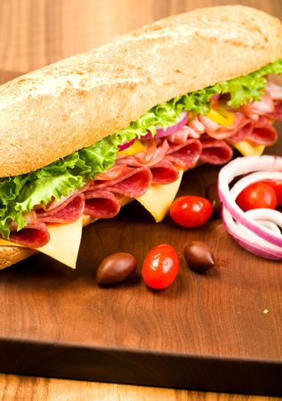 Footlong Salami, Ham, cheese sub with lettuce, tomato, onion and peppers photo