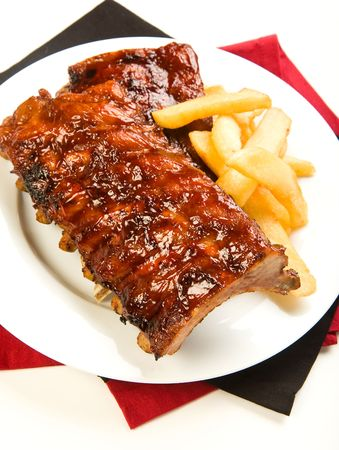rib: Ribs with smoky spicy sauce accompanied by french fries