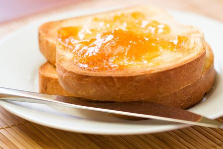 broiled: Thick sliced homemade bread broiled with butter served with apricot preserves
