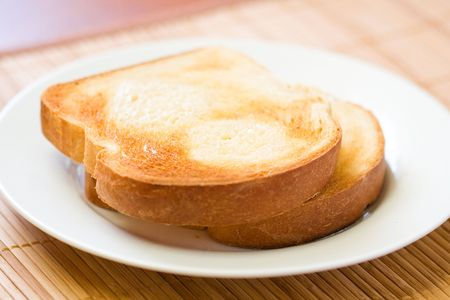 toasted: Thick sliced homemade bread broiled with butter