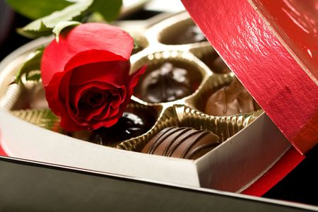 Valentines day roses, candies and wine on black tray