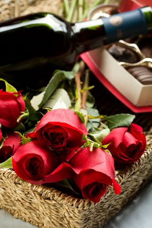 Roses, Wine and Chocolates in a large wicker tray Stok Fotoğraf