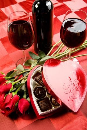 Valentine's day roses, candies and wine on black tray Stock Photo - 6245545