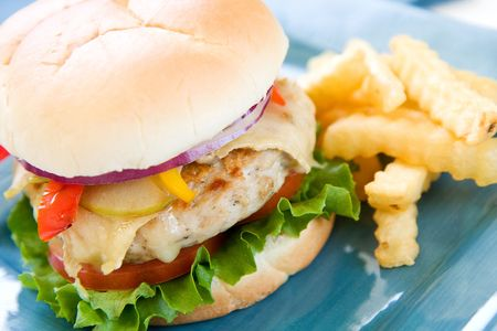 Healthy turkey burger with brie, apple, peppers, tomato, lettuce and onion Stock Photo