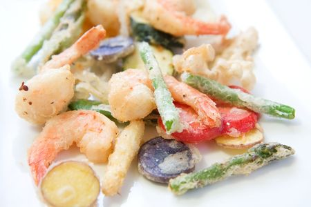 Shrimp and a variety of tempura fried vegetables including potato, string bean, asparagus, and peppers Stock Photo - 6720354