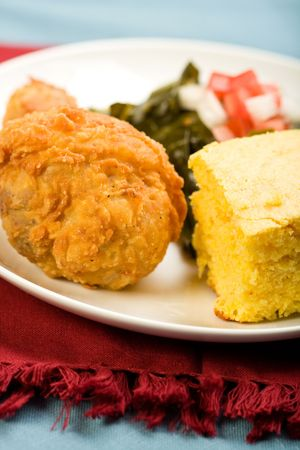 Fried Chicken served with collard greens and cornbread photo