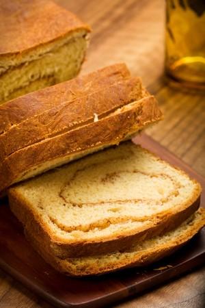 freshly made cinnamon swirl bread on bread board photo
