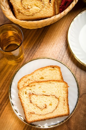 freshly made cinnamon swirl bread on white plate Banco de Imagens