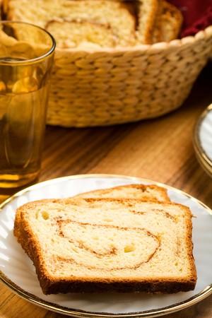 freshly made cinnamon swirl bread on white plate Archivio Fotografico