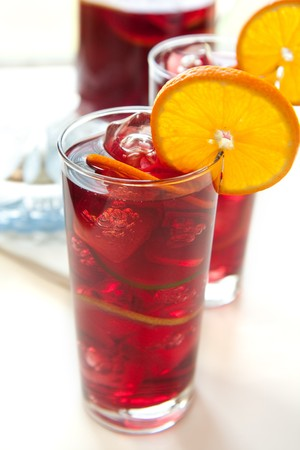 Ice cold wine drink with orange, lemon, and lime photo