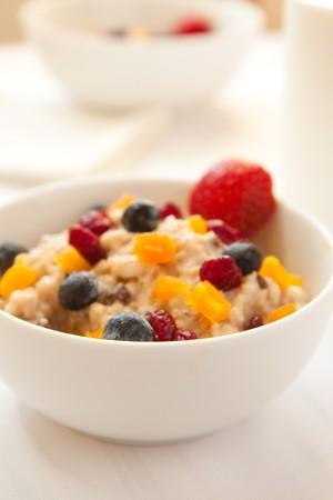 A fiber rich rich breakfast complete with fresh and dried fruits photo