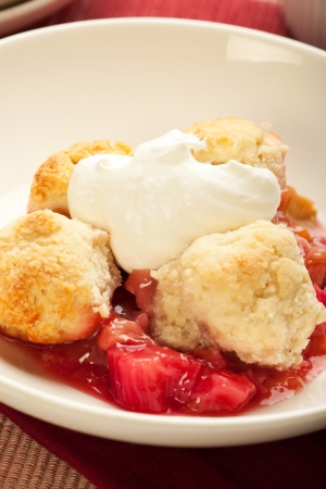 Fresh strawberry rhubarb cobbler with whipped cream