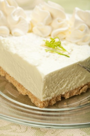Tangy, refreshing key lime pie on glass plate