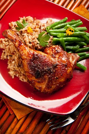 accompanied: Duck with tamarind sauce accompanied by wild rice and green beans