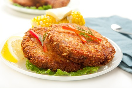 Large dinner sized salmon croquettes served with corn