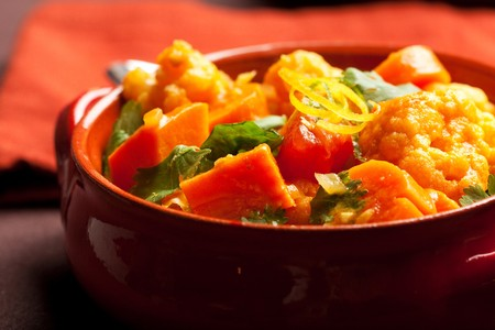 Spicy indian vegetable curry with cauliflower, sweet potato, and carrot Stock Photo
