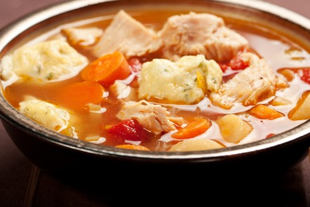 Turkey Dumpling soup with carrot, tomato, and parsnip photo