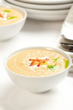 Celeriac and apple soup topped with gruyere and bacon