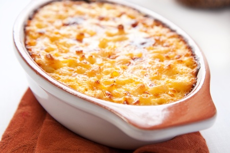crispy, creamy, and cheesy macaroni and cheese is great for one and all! Stock Photo