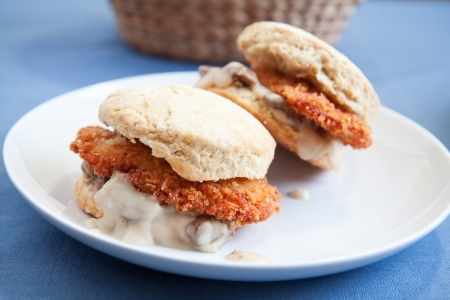 Thinly sliced crispy fried chicken with creamy gravy and mushrooms on a fluffy biscuit Stock Photo - 8710377