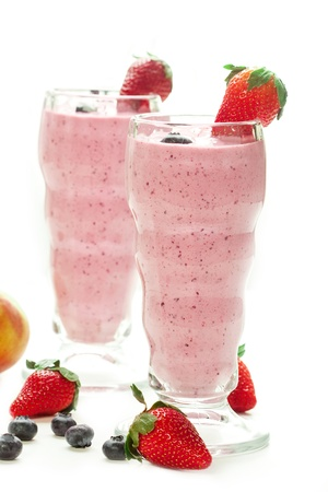 Berry smoothie accompanied by fruit in a vintage glass Stock Photo