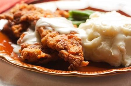mashed: Thin Steak fried and covered in gravy accompaned by mashed potatoes and green beans