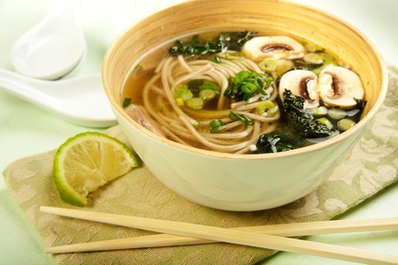 asian noodle: Black Tuscan Kale and Soba noodle in a vegetable broth with mushroom Stock Photo