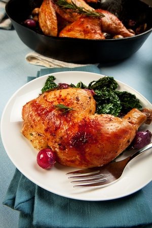 Chicken leg quarter with black tuscan kale photo