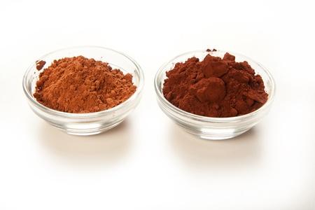 Comparison shot of dutch processed cocoa and natual cocoa powder Stock Photo