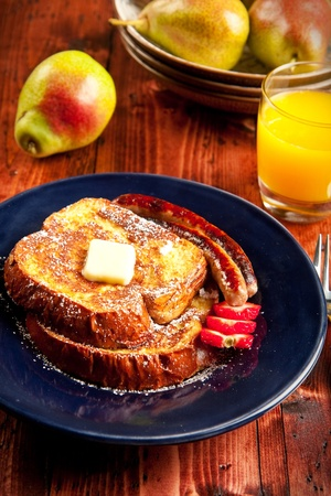 bread toast: Sausage accompanies French toast in a delicious breakfast