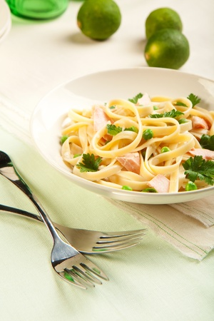 Salmon fettuccine with peas a creamy sauce and parsley photo