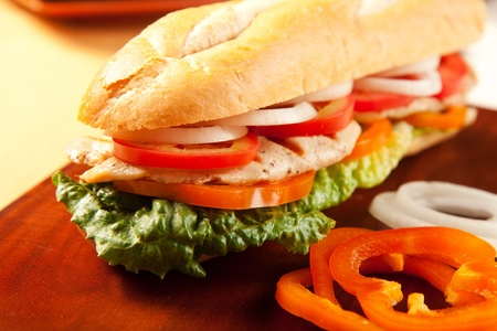 sandwich bread: Grilled chicken sandwich with orange pepeprs, tomato, lettuce and onions