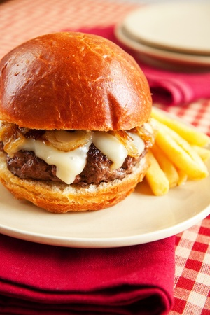 melted cheese: Thick rare cheeseburger with swiss cheese and caramelized onions served with french fries