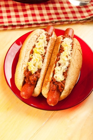 Perfect for the big game,  picnic, party or anytime, chili dogs with sauerkraut. photo