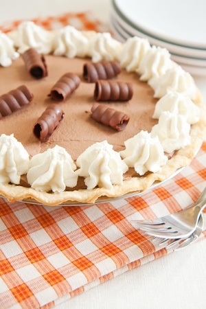 Light and chocolately French Silk Pie with penty of whipped cream and chocolate curls