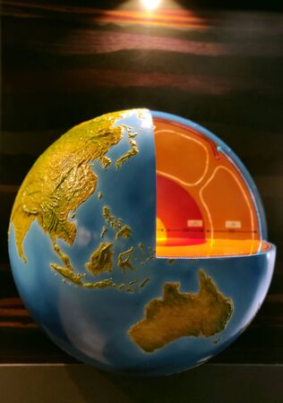 Earth core representation under yellow light with south East Asia and Australia clearly visible