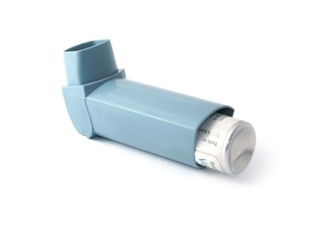 bronchial: Blue asthma inhaler isolated on white background               Stock Photo