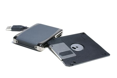 ms: Card reader for cf, ms, ms duo pro, sd, sm, mmc, etc. with 1,5 floppy isolated on white              Stock Photo